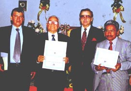 Brethren receiving diplomas from the Colombian Baptist Institute
